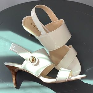 Coach low heel sandal.